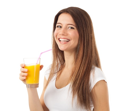 Nice young woman with a glass of orange juice, isolated on white