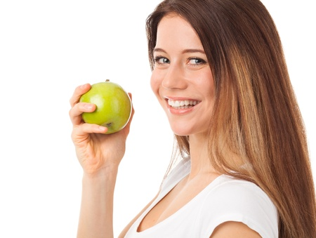 Nice young woman holding a green apple, isolated on white Stock Photo