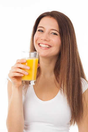 Pretty young woman with a glass of orange juice, isolated on white photo