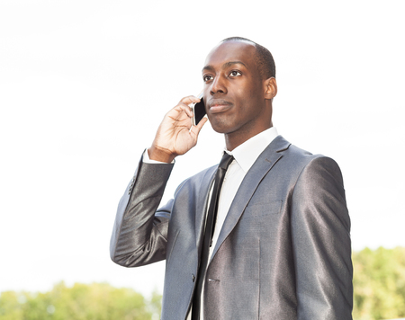 telephone salesman: Portrait of a businessman on the phone, outdoor Stock Photo