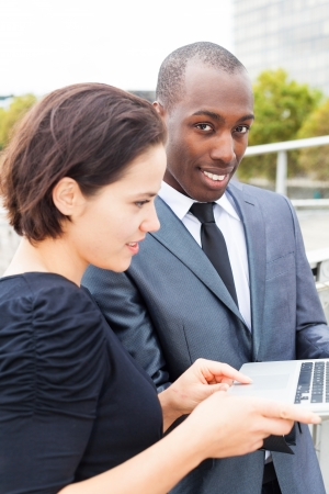 collaborators: Businesswoman presenting the project to her collaborator or client
