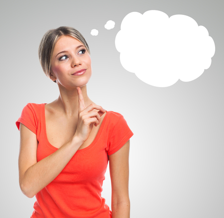 woman thinking: Young woman thinking, having an idea, with cartoon bubble concept