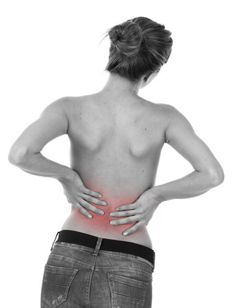 lumbar spine: Woman having ache on lower back, isolated on white Stock Photo