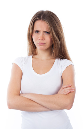 Portrait of an unhappy woman with arms crossed, isolated on white