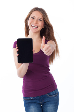 Cheerful woman showing an electronic tablet and having a positive gesture photo