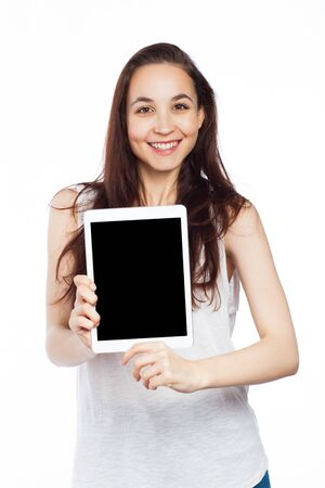 Beautiful woman displaying a tablet, isolated on white Standard-Bild