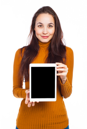 Young woman showing a blank touchpad, communication concept, isolated on white