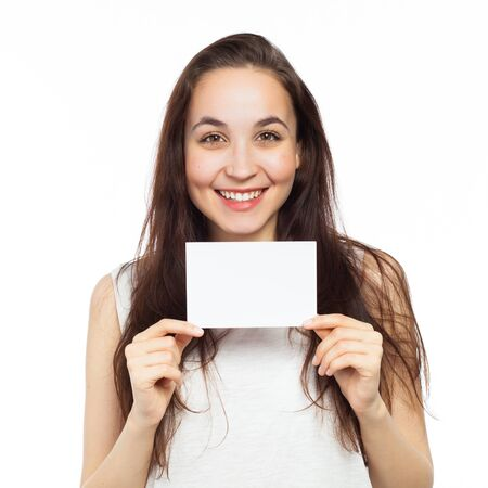 Cheerful young woman showing a blank signboard, isolated on white