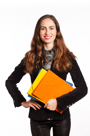 Portrait of a smiling working girl holding some folders, isolated on white