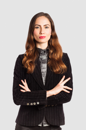 Portrait of a businesswoman, on grey background