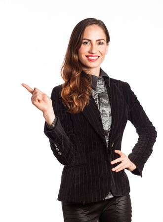 Portrait of an attractive woman pointing up at copy space, isolated on white