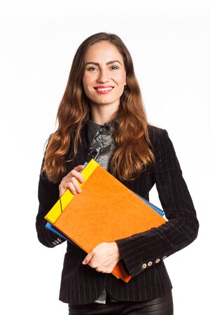 Portrait of a beautiful working woman with folders, isolated on white Standard-Bild