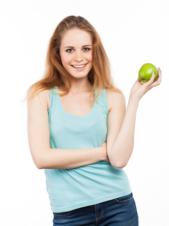 Portrait of a beautiful girl with a green apple, isolated on white Standard-Bild