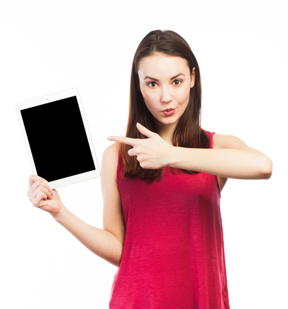 Young woman showing the blank screen of an electronic tablet, isolated on white Standard-Bild