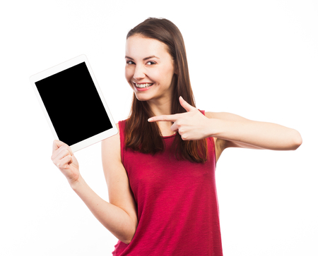 Joyful woman holding and showing the blank screen of an electronic tablet, isolated on white