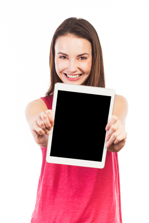Attractive young woman showing the blank screen of an electronic tablet, isolated on white