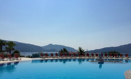 A swimming pool overlooking a mountain range in Turkey Stock Photo