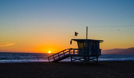santa monica: A lifeguard station on Santa Monica beach at sunset