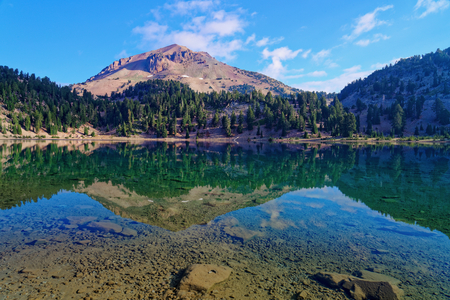 Reflections off Lake Helen in Lassen Volcanic National Park, California