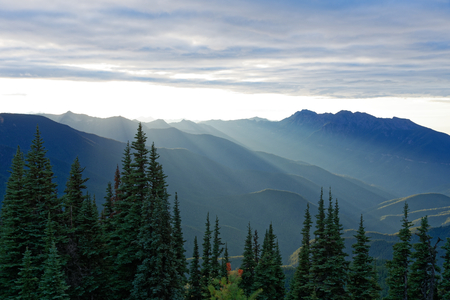 Sun setting behind the Olympic Mountains on Olympic National Park, Washington Stock Photo