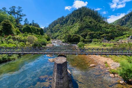 An old suspension bridge running through the Karangahake Gorge
