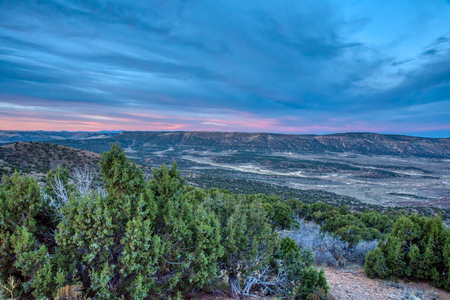 Sunset in Southwest Wyoming with a typical landscape shrubs and rocky outcrops Reklamní fotografie