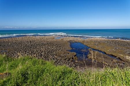 Rugged black sand beach along the Surf Highway in Taranaki