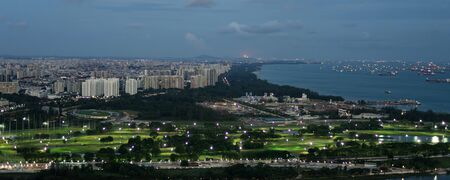 Vista of the Singapore Straight with cargo ships docked in the distance