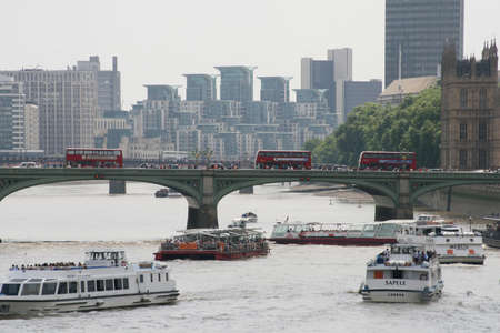 Riverboats along the River Thames in London, UK