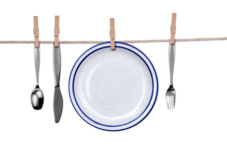 Fork, knife, spoon and plate on a clothesline isolated over white