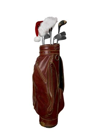 Vintage worn clubs with Santa hat in an old bag isolated over a white background photo