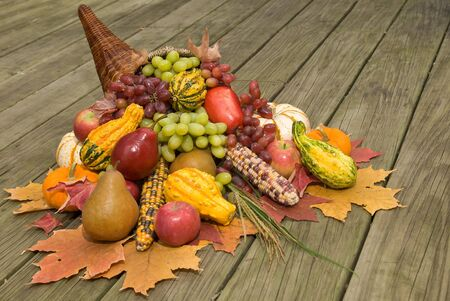 filled out: Cornucopia filled with fall harvest spilling out of its horn of plenty