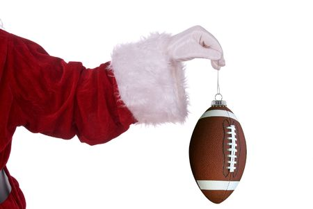 Santa Claus with football ornament in his white gloved hand Stock Photo