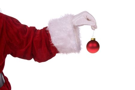 st nick: Santa Claus holding a red ornament in his white gloved hand Stock Photo