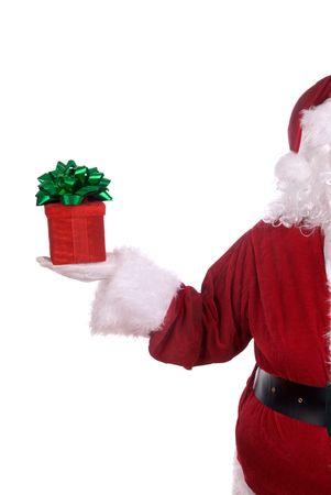 그의 하얀 낀 손에 선물 산타 클로스 스톡 콘텐츠