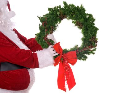 st nick: Santa Claus holding a wreath in his white gloved hands