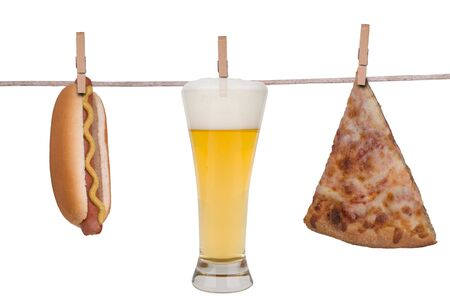 Hotdog,glass of Beer and a slice of pizza hanging on a clothesline isolated on white