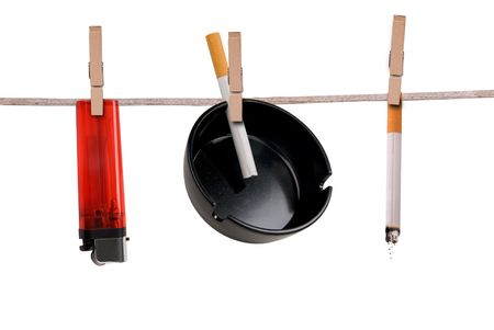 ashtray: Cigarette,ashtray and lighter on clothesline isolated on white
