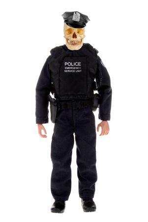 De plástico de juguete oficial de la policía muñeca con un cráneo aislado más de blanco  Foto de archivo - 2110610