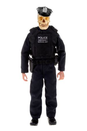 plastic toy police officer doll with a skull isolated over white Stock fotó