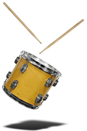 snare: close up of side view of a snare drum floating with drum sticks isolated over white