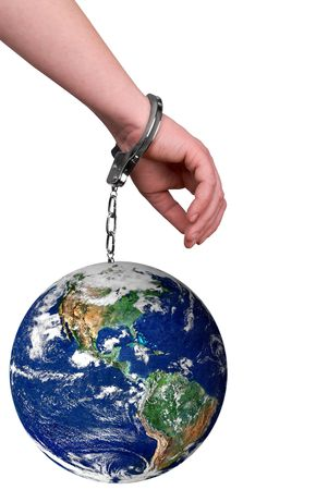 handcuffed: One hand handcuffed to the earth isolated over white Stock Photo