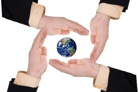 Business men holding earth in thier hands isolated on white photo