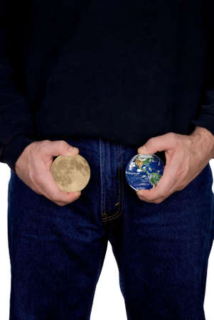 Man holding Earth and Moon in hands below his waist isloated over white