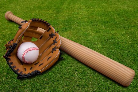 Baseball bat, ball and glove isolated on a field of grass Stock Photo