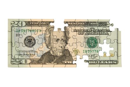 Twenty dollar bill with pieces missing isolated over white photo