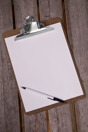 Clip board with pen and blank paper
