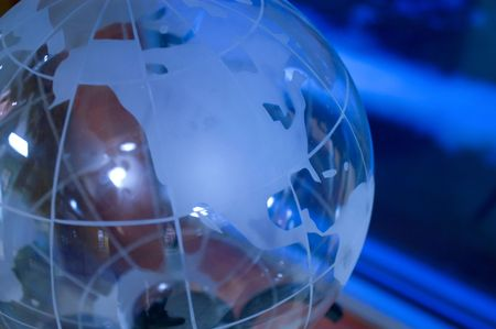 conceptional: Glass globe under blue light source Stock Photo