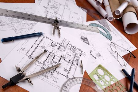 architect tools: engineer, architect or contractor plans and tools laid out on a wooden table Stock Photo