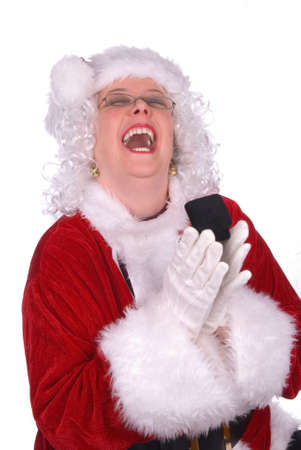 Mrs. Claus is laughing loudly with an engagement ring in her gloved hands Stock Photo - 2110733
